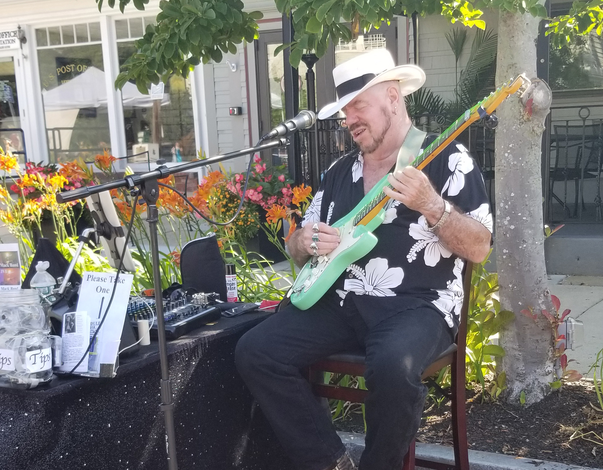 rock star joe mack performing at the farmers market
